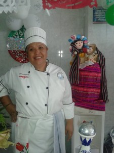Lidia Morales in Chef uniform