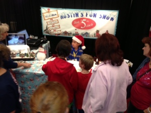 Austin at booth selling snow